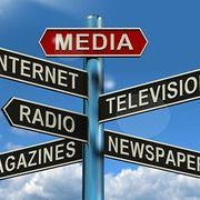 Image of a street sign pointing to multiple types of media